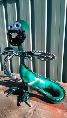 dragon l made from motorbike parts check us out on facebook Pop's Art & Co