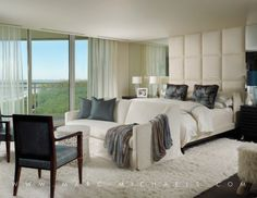 Contemporary Master Bedroom with Balcony, Upholstered square back armchair, sliding glass door, Paint 1, Standard height