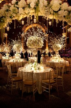 """idea for the large centerpieces. use white feathers instead of orchids as the demention piece.  Floral archway upon entry into """"the gates of heaven""""."""