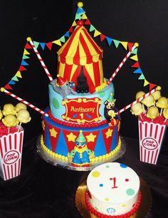 Circus themed cake, smash cake and cake pop centerpieces. Cake has handmade fondant figurines (i.e. seal, monkey and clown) and a circus tent made of cake. Cake pops are made to look like popcorn by using mini marshmallows at the bottom.   For more pics of our work, visit our website: www.simplysweetonline.com