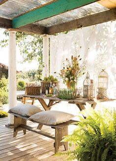 Outdoor dining ~ love the curtain