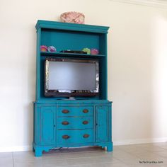 "Convert old china hutch into entertainment center.  Takes up less space than an armoire and ""hides"" the TV better than a stand or media console."
