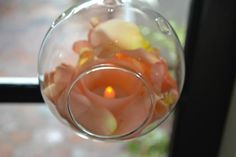 fleurish floral designs  Glass bubble with petals and candles