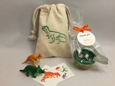 Dinosaur Party Favor: Dinosaur Party Bag filled with Play Doh and Dinosaur Cutter, Tattoos and Dino Toys by MadHatterPartyBox on Etsy https://www.etsy.com/listing/245116992/dinosaur-party-favor-dinosaur-party-bag