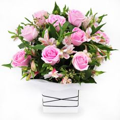 Shimmer - pink roses and peruvian lilies in a clean white box.