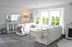 Ikea Ektorp sofas in Blekinge white help to make this living room clean, calm and comfortable. #LivingRoom #furniture