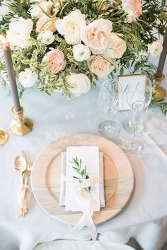 A Timeless, neutral hue table setting for a Breezy Seaside Wedding with Cascading Greenery
