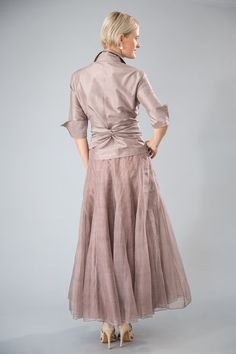Sewn in 28 panels, with a draw-string waist, the pure silk bohemian skirt is perhaps the most flattering of Living Silk's skirts. Teamed with the Classic Wrap Shirt, it is a magnificent outfit that is perfect for the mother of the bride, mother of the groom, a guesst attending a wedding or a cocktail or formal event. Shown here in Coffee. Available in a range of colours.