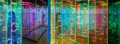 as viewers move through the installation, the hues gradate from cool blues and greens, to vibrant pink and orange tones.