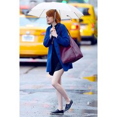 Emma Stone's Secret to Looking Good (Even In a Downpour) ❤ liked on Polyvore featuring emma stone