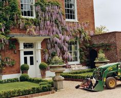 Does it get any more beautiful than Wisteria climbing up brick?  Stella McCartney's country home from Vogue.