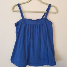 Royal Blue Top Cutest top!!! Royal blue cotton tank with adorable hem, button detail at back of neck. Pre-loved! H&M size 6, I would say it fits like a S/M. Body is Flowy so would be flattering on either size.    Bundle to save 20% H&M Tops Tank Tops
