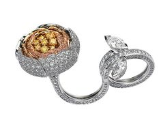 Van Cleef & Arpels Pivoine Ring: White gold, round, marquise-cut and princess-cut diamonds and yellow gold, round yellow and pink diamonds.