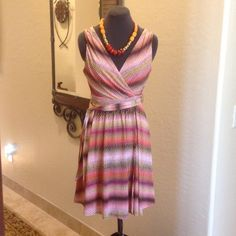 MARC NEW YORK Multi Patterned Dress MARC NEW YORK Gorgeous Multi Print Dress. Beautiful fabric with shades of Coral/Yellow/Black/Pink  with a matching tie belt. Splits in the front and is fully lined. High quality fabric..glides right on!  MARC NEW YORK Dresses