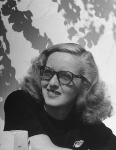 Bette Davis wearing glasses. Cool.