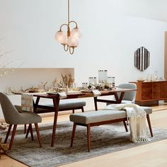 Mid-Century Expandable Dining Table | west elm We really like this expandable table and the use of benches for the side seating. We rarely use dining space as a couple, but host game nights and meetings frequently.