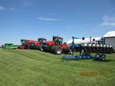 Blue,red & green farm equipment r-l:Kinze 3500 corn planter,CaseIH Steiger 500,550,8010 axial flow,John Deere 9870