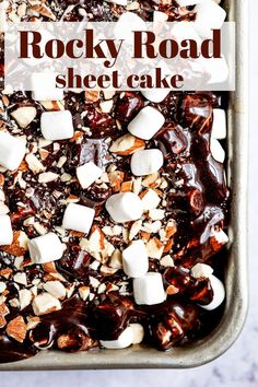Rocky Road Chocolate Sheet Cake is a homemade chocolate sheet cake topped with marshmallows, rich chocolate frosting, and chopped almonds!