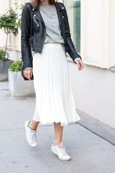 White pleated skirt, black leather jacket, grey sweater and white sneakers - perfect autumn look