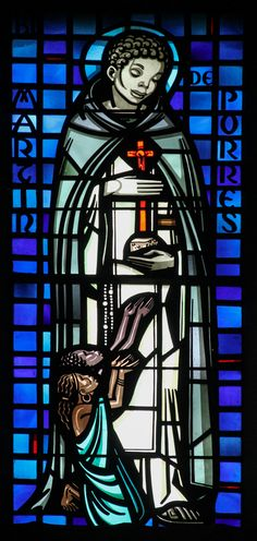 """""""The LORD takes delight in his people, honors the poor with victory."""" Psalm 149:4 // Saint Martin de Porres // Stained glass window from Baltimore Cathedral // Photo: Lawrence OP"""