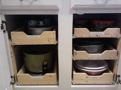 DIY sliding shelves in kitchen cabinets with a GREAT tutorial