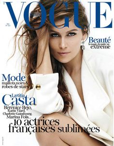 Laetitia Casta graces the cover of the May 2012 issue of Paris Vogue in an Alexander McQueen dress. Shot by Mario Testino