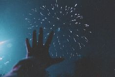 Watching fireworks as a small child, reaching out my hands towards the shards of light and fire