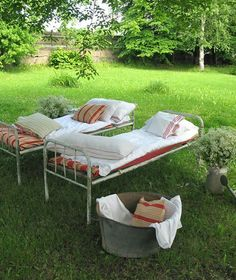 beds in the yard...back in the 30's, 40s and 50's this is how folks dealt with hot summers and lots of company....didn't have to worry about thugs coming by and attacking you either.....the good ole days........where have they gone???