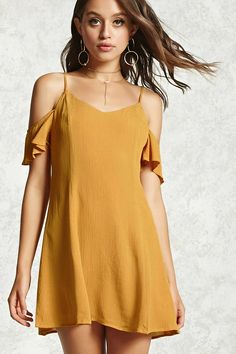 A crinkle woven dress featuring a scoop neck, adjustable cami straps with a back strap design, draped ruffle short sleeves, a hidden back zip closure, and a shift silhouette.