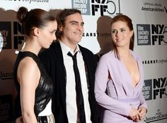 "Actors Rooney Mara, left, Joaquin Phoenix and Amy Adams attend the 51st annual New York Film Festival closing night screening of ""Her"" at Alice Tully Hall on Saturday, Oct. 12, 2013 in New York. (Photo by Evan Agostini/Invision/AP) **"