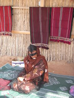 Selling beautiful wares in the Omani desert.