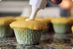 To fill cupcakes, use a pastry bag and round tip. Insert the tip into the center of the cupcake and squeeze the filling in until it begins to come out of the top.