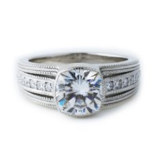 Custom engagement ring made in platinum and featuring moissanite and diamonds. Custom engagement rings by Abby Sparks Jewelry, custom jewelry designer in Denver, Colorado.