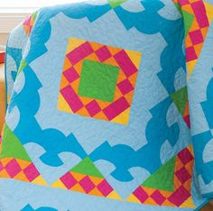 """Use the GO! Drunkard's Path-4"""" and GO! Half Square Triangle dies. You can get ultra creative with your blocks to form a mixture of curves and squares that can make a quilt like this one!"""