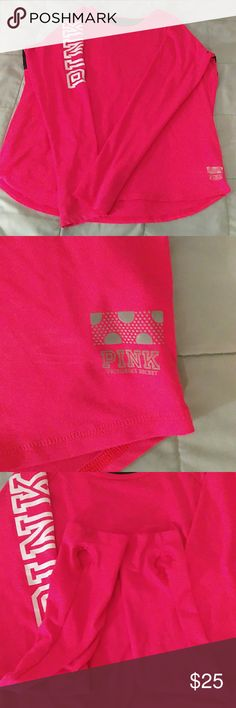 Victoria Secret Pink shirt Hot pink color.  has the holes for your thumbs to go throw makes your sleeves stay put lol.  has a black net top on the upper back part.  Size large.  smoke and pet free home. PINK Victoria's Secret Tops Tees - Long Sleeve