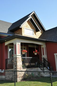 A wide, inviting porch unique to Craftsman style homes.  www.coopercrossing.ca  #coopersairdrie #architecture