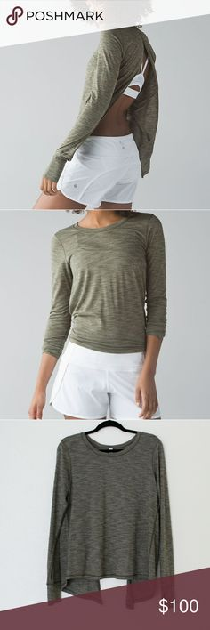 RARE!! Lululemon beat the heat long sleeve. Beat the heat long sleeve color Heather green (Olive green). Only worn this 2 times. Has reflective detail on the bottom sleeve by thumb holes. In mint condition!! Size 10 but can easly fit an size 8.   ******** price is negotiable, but keep in mind this is a rare top and color, so please no low balling offers******** lululemon athletica Tops