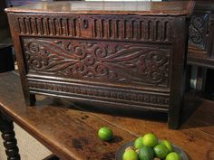 "SMALL EARLY 17TH CENTURY OAK PANELLED COFFER.    THE SINGLE PLANKED TOP ABOVE A KNULL CARVED FRIEZE. THE FRONT WITH A BEAUTIFULY CARVED SCROLLWORK PANEL. THE SIDES WITH AN ARCADED CARVED PANEL WITH LEAF DECORATION. EXCELLENT COLOUR AND PATINATION. 30"" WIDE X 11.5"" DEEP X 18.5"" HIGH."