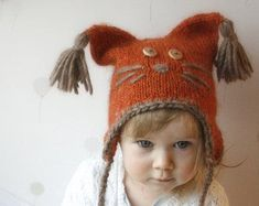 This is a knitting pattern for earflap Squirrel hat Sibo. Worked in round with aran yarn, decorated with tassels and basic embroidery. Make this hat with or without the earflaps.Perfect to wrap up those cold autumn and winter days. Baby Hat Patterns, Knitting Patterns, Double Pointed Knitting Needles, Super Bulky Yarn, Animal Hats, Knit In The Round, Stockinette, Cool Hats, Baby Hats