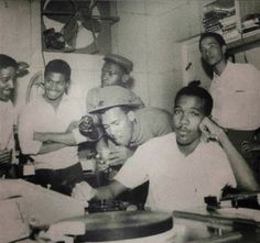 """Fantastic photo of CLEMENT """"COXSONE"""" DODD in the control room of Federal Studio in 1961 with ROLAND ALPHONSO, CLANCY ECCLES, DON DRUMMOND, DESMOND ELLIOTT and HERMAN SANG."""