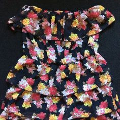 Floral Summer Dress  Very stretchy, the side of the dress has belt loops so you can add a cute belt to cinch your waist. I love this floral design on this dress. Thank you for checking out my closet. Papaya Dresses Strapless