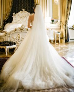 Wearing a Veil  / This custom originated in Rome, when a bride would wear a veil down the aisle to disguise herself from evil spirits who were jealous of her happiness.