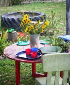 an invitation to play in the outdoor kitchen
