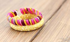 DIY Duct Fabric Tape Bangle Bracelet - - The idea to handcraft this DIY duct fabric tape bracelet from shower curtain is just matched with modern terms of jewelry fashion as well as the ingenious and. Iron On Fabric, Fabric Tape, Glitter Fabric, Duct Tape Jewelry, Duct Tape Bracelets, Ring Bracelet, Bangle Bracelets, Bangles, Found Object Jewelry