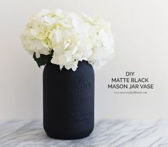Here an easy, peasy DIY that takes less than 15 mins to make and can be  added to anyone who loves the black & white color scheme. Simple gather the  few items below, paint and decorate with your favorite white flowers, and  you can have a cute mason jar vase as part of your décor for office or home  or even as a gift. Enjoy! - xo Mel