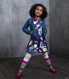 Children's wear buyers fell for Tea Collection's Chinese-inspired patterns and jewel-toned palette. Buyers paired the happy-patterned Eastern Pop Bubble Dress with the French Terry Mock Neck Zip Up in a saturated tone of teal, and kept the layering going with Pop Art Stripe Stretch Leggings. www.teacollection... (buyers' pick)