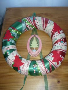 Polystyrene wreath wrapped in christmas ribbon and decorated with odds and ends :-)