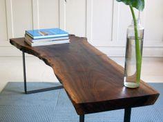 Live edge dining table on metal/chrome legs. Custom piece.