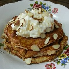 Basic Protein pancakes   Egg whites, coconut flour, protein powder and banana for the batter. Topped with cottage cheese, silvered almonds and WF pancake syrup Ingredients for batter: 1/2 cup liquid egg whites (3-4 egg whites)1/2 mashed banana 1/2 scoop whey protein powder (I used Elite Cappuccino Rush)1 tbsp coconut flour If you want this recipe to be all paleo, skip protein powder and add 2 more tbsp of coconut flour.