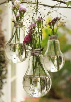 Love the idea of hanging lightbulb vases from trees in an outdoor venue, or suspended above a table.